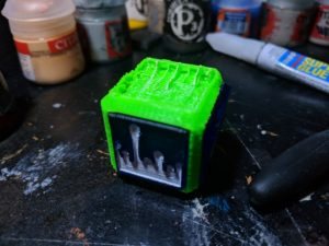 3d printed cube with token insert